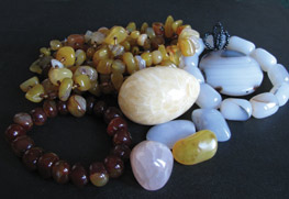 various colors of chalcedony tumbled stones and necklaces