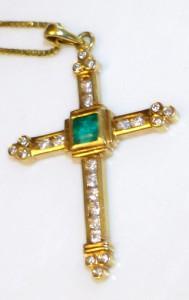emerald plus diamonds on a golden cross