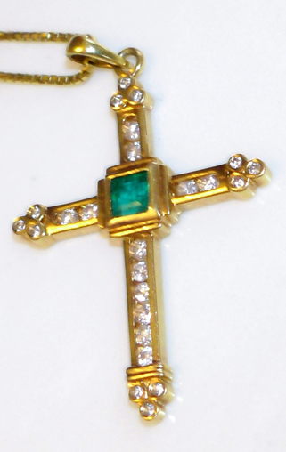 emerald plus diamonds on a golden cross
